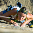 Image of pretty woman climbing on the rock...