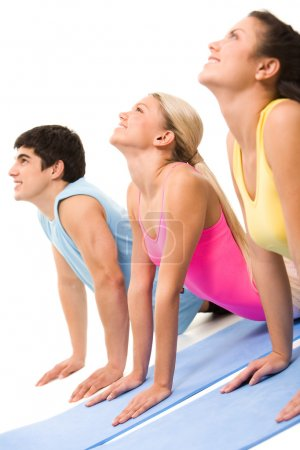 Photo for Portrait of young sporty doing stretching exercise on floor - Royalty Free Image