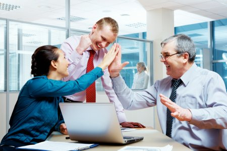 Photo for Image of glad businesspeople congratulating each other on corporate victory - Royalty Free Image