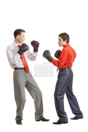 Photo for Portrait of two businessmen in boxing gloves fighting - Royalty Free Image