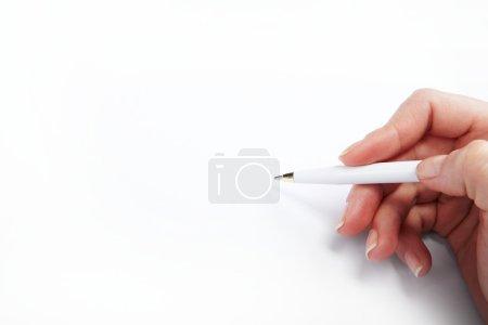 Photo pour Image de la main avec stylo sur papier blanc - image libre de droit