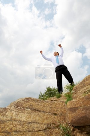 Photo for Photo of relaxed businessman standing and raising his arms outdoors in summer - Royalty Free Image