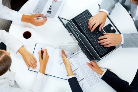 Photo for Above view of several business working at meeting - Royalty Free Image