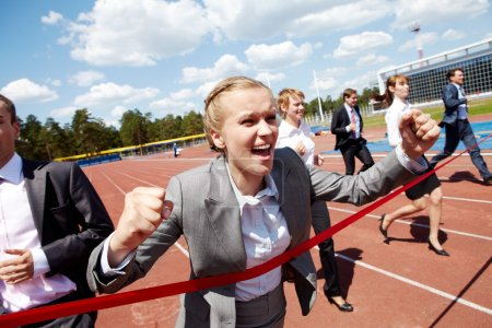 Photo for Photo of happy businesswoman crossing finish line during race - Royalty Free Image