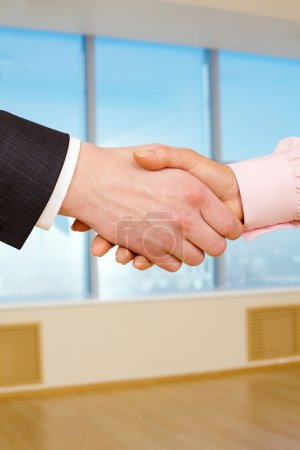 Photo for Close-up of handshake of two businesspeople after signing promising contract - Royalty Free Image