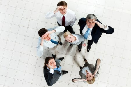 Photo for Portrait of confused business group standing on the floor and looking at camera - Royalty Free Image