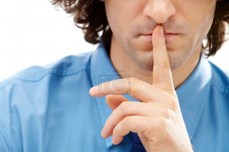 Photo for Image of gesture: male finger over lips - Royalty Free Image