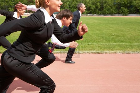 Photo for Image of active employees running down sport track - Royalty Free Image
