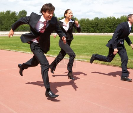 Photo for Photo of energetic business in suits running - Royalty Free Image