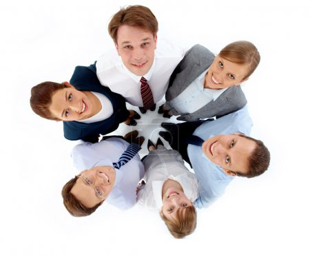 Photo for Above view of several successful associates looking at camera while embracing each other - Royalty Free Image