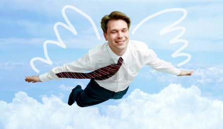 Photo for Conceptual image of smiling businessman with wings flying in the clouds - Royalty Free Image