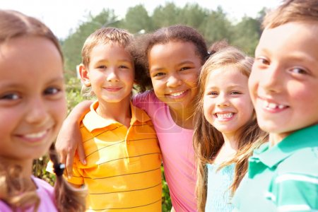 Photo for Portrait of happy preschoolers looking at camera while embracing - Royalty Free Image