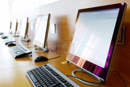 Photo for Photo of row of computers in classroom of college or other educational institution - Royalty Free Image