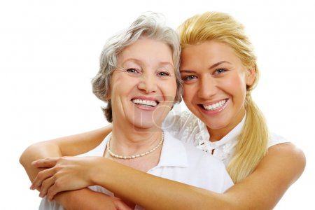Photo for Portrait of daughter embracing her mother and looking at camera - Royalty Free Image