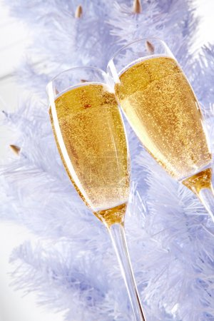 Photo for Two champagne flutes with firtree behind - Royalty Free Image