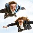 Conceptual image of young business partners flying...