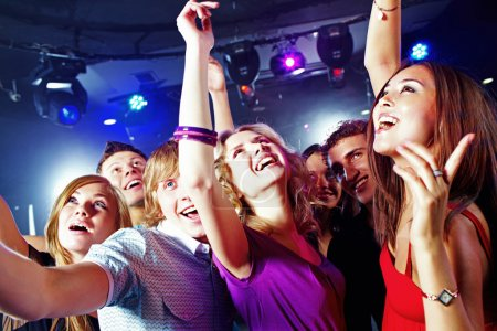 Photo for Image of pretty girls dancing with their boyfriends in night club - Royalty Free Image