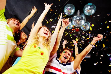 Photo for Photo of excited teenagers raising their arms in joy - Royalty Free Image