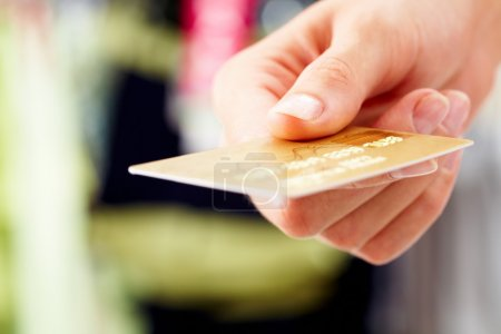Photo for Close-up of credit card in human hand in the shop - Royalty Free Image