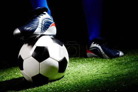 Photo for Horizontal image of soccer ball and shoes - Royalty Free Image
