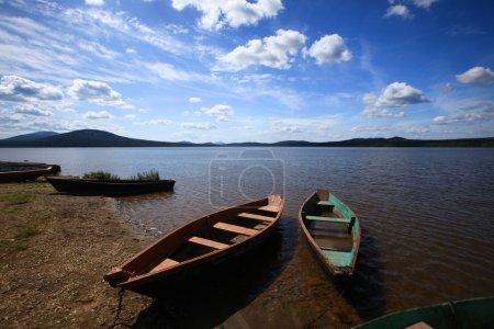 Boats near lake