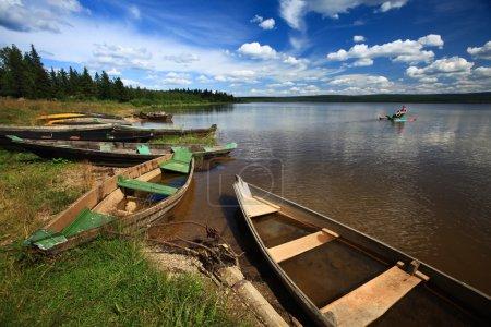 Boats by lake