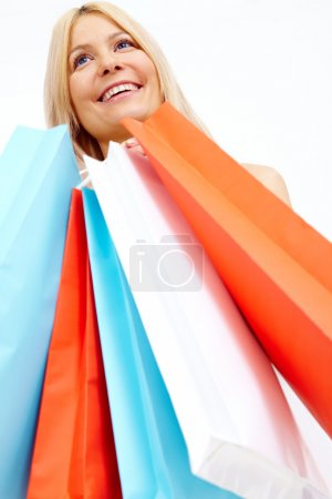 Photo for Photo of happy female with colorful shopping bags - Royalty Free Image