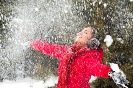 Photo for Portrait of beautiful woman taking pleasure on snowy winter day - Royalty Free Image