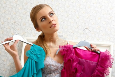 Photo for Image of pretty female thinking what dress to wear on New Year night - Royalty Free Image