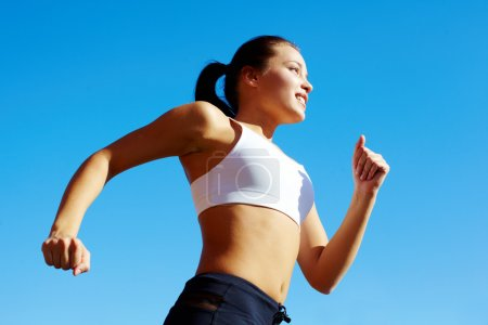Photo for Portrait of a young woman jogging - Royalty Free Image