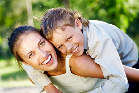 Photo for Happy mother holding her cute son and both laughing - Royalty Free Image