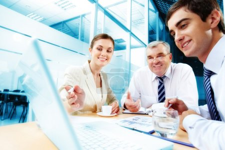Photo for A business team of three sitting in office and planning work - Royalty Free Image