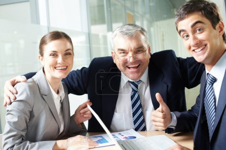 Photo for Portrait of joyful business group showing their gladness and looking at camera - Royalty Free Image