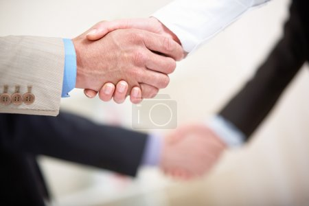 Row of handshakes