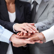 Image of business hands on top of each other symbo...