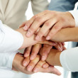 Image of businesspeople hands on top of each other...