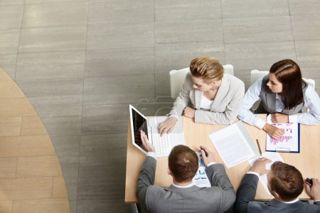 Photo for Image of business partners sitting at table and planning work - Royalty Free Image