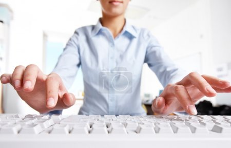 Photo for Image of female hands pressing computer keys at workplace - Royalty Free Image