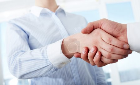 Photo for Photo of handshake of business partners after striking deal - Royalty Free Image
