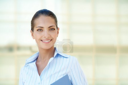 Photo for Portrait of pretty employee smiling at camera - Royalty Free Image