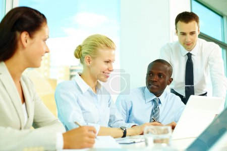 Photo for Four business discussing affairs in office - Royalty Free Image