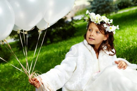 Photo for Portrait of girl bride with balloons sitting in park - Royalty Free Image