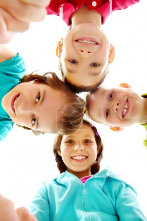 Photo for Company of four joyful children looking at camera - Royalty Free Image