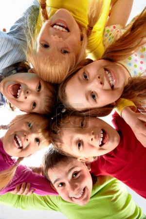 Photo for Team of happy kids embracing each other - Royalty Free Image