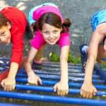 Three little children climbing ladder and looking ...