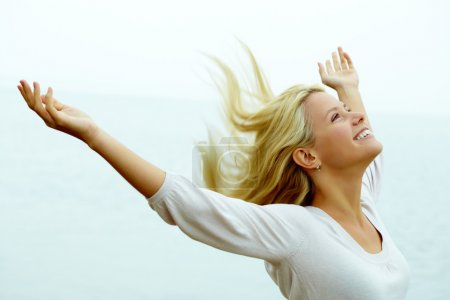 Photo for Portrait of happy young girl with stretched arms enjoying life - Royalty Free Image