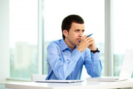Photo for Portrait of pensive businessman thinking of something in office - Royalty Free Image