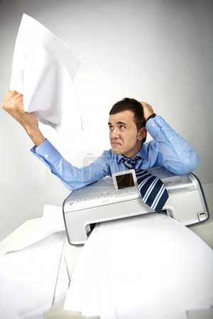 Photo for Portrait of nervous businessman holding printed papers - Royalty Free Image