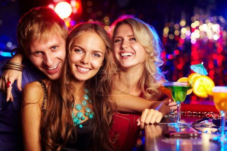 Photo for Image of happy friends looking at camera at party - Royalty Free Image
