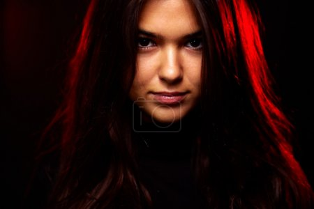 Photo for Face of young woman in the dark - Royalty Free Image